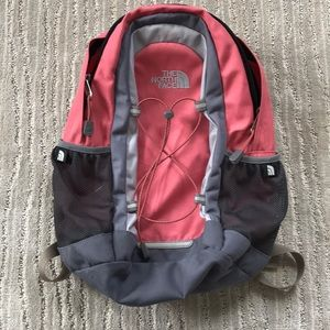 Pink north face back pack